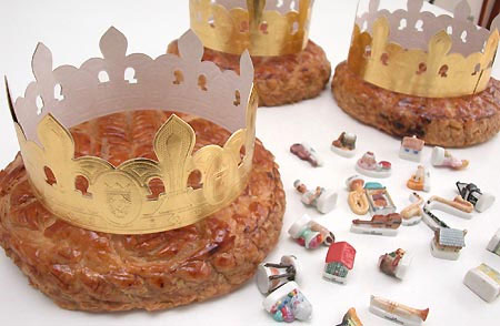 Galette des Rois with paper crowns and ceramic trinkets